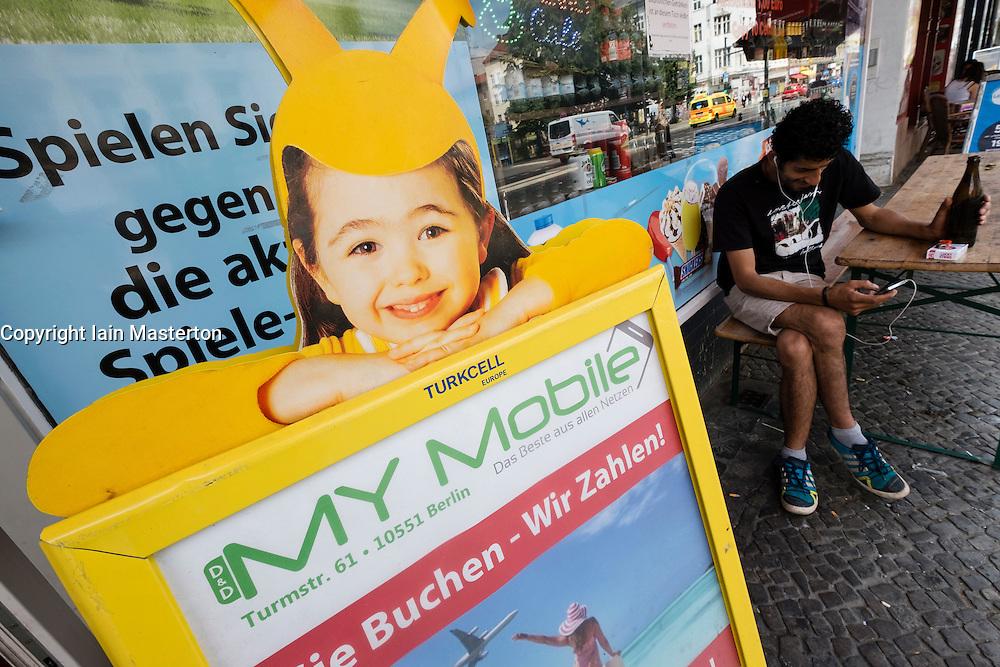 Advertisement for Turkcell Turkish mobile phone company outside shop in Neukolln Berlin Germany