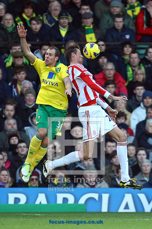 Picture by Paul Chesterton/Focus Images Ltd +44 7904 640267.03/11/2012.Steven Whittaker of Norwich and Peter Crouch of Stoke contest a header during the Barclays Premier League match at Carrow Road, Norwich.