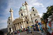United Buddy Bears exhibition in front of Karlskirche, Vienna..An idea on its tour around the word: 137 Buddy Bears, created in Berlin/Germany, are standing peacefully hand in hand to represent 137 United Nations member states. An exhibition under the motto WE HAVE TO GET TO KNOW EACH OTHER BETTER it makes us understand one another better, trust each other more and live together more peacefully..The idea for this exhibition was created 2002 by the inventors of the Buddy Bears Eva and Klaus Herlitz. More than 140 artists, each one coming from the country his bear represents, show the art style of their home countries. Standing in a circle the bears form a unique work of art altogether. The individual design of each bear includes a lot of information about the different countries. Together with the symbolism of the circle love, peace, friendship, tolerance and international understanding are promoted. In each city where the circle is shown activities (e.g. auctions) raise money for children in need. .At the end of the world tour and in between the bears will be sold by charitable auction for UNICEF and other organisations helping needy children all over the world.
