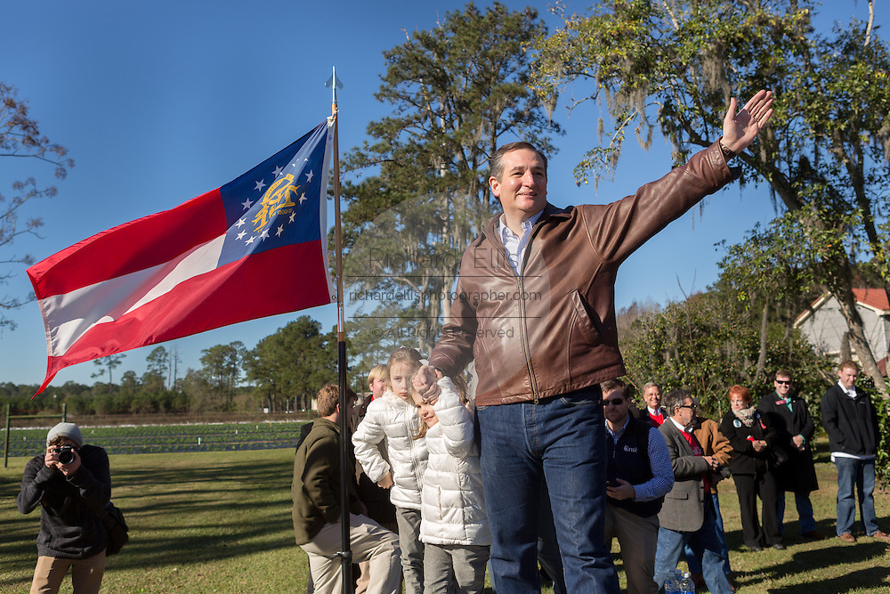 U.S. Senator and GOP presidential candidate Ted Cruz waves to supporters during a campaign event at Ottawa Farms December 19, 2015 in Bloomingdale, Georgia.