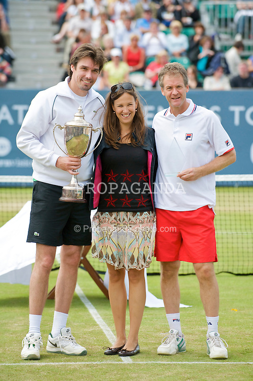 LIVERPOOL, ENGLAND - Sunday, June 21, 2009: Michael Stich (GER) holds the legends' trophy with Anders Jarryd and Tradition's Regina Malzburg during Day Five of the Tradition ICAP Liverpool International Tennis Tournament 2009 at Calderstones Park. (Pic by David Rawcliffe/Propaganda)