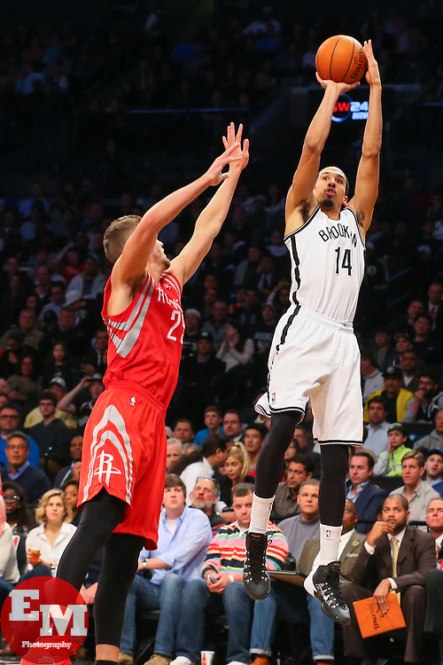 Apr 1, 2014; Brooklyn, NY, USA; Brooklyn Nets guard Shaun Livingston (14) shoots the ball while being defended by Houston Rockets forward Chandler Parsons (25) during the fourth quarter at Barclays Center. The Nets defeated the Rockets 105-96.