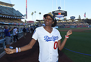 Jun 13, 2018; Los Angeles, CA, USA; Kendall Ellis  poses before a MLB game between the Texas Rangers and the Los Angeles Dodgers at Dodger Stadium. Ellis ran the anchor  leg of the Southern California Trojans women's 4 x 400m relay team that won the NCAA title to clinch the national team championship.