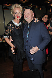 AMANDA ELIASCH and STEPHEN JONES at a dinner in honour of Andre Leon Talley and Manolo Blahnik held at The Spice Market restaurant at W London, Leicester Square, London on 14th March 2011.