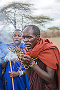 Africa, Tanzania, Maasai an ethnic group of semi-nomadic people. Man lights a fire