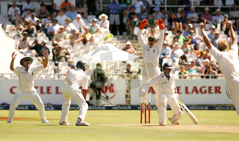 WESTERN CAPE, SOUTH AFRICA - 2nd January 2007, Mark Boucher celebrates Paul Harris's first test wicket with the dismissal of Dinesh Karthik (India) during day 1 of the third test between South Africa and India held at Newlands Stadium, Cape Town...Photo by RG/Sportzpics.net