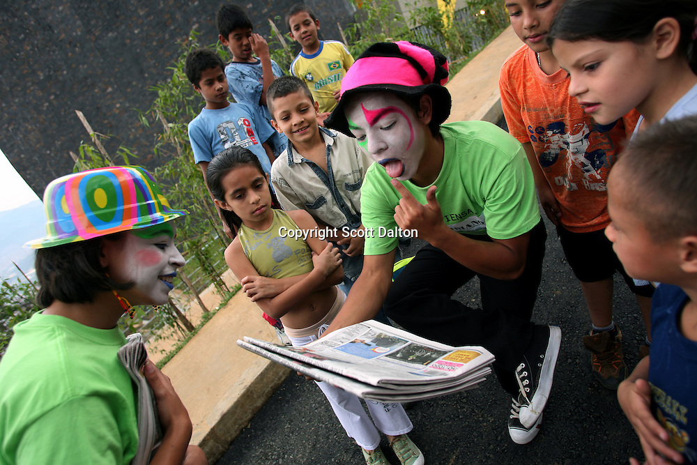 Children watch mimes perform in front of the newly built biblioteca España in the barrio Santo Domingo Savio, in Medellin on May 19, 2007. (Photo/Scott Dalton)
