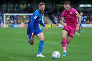 AFC Wimbledon midfielder Scott Wagstaff (7) taking on Rochadale defender Rhys Norrington-Davies (3) during the EFL Sky Bet League 1 match between AFC Wimbledon and Rochdale at the Cherry Red Records Stadium, Kingston, England on 5 October 2019.