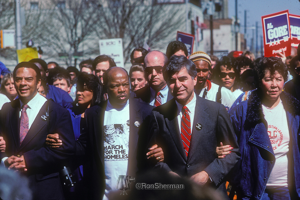 Homeless March in downtown Atlanta GA in 1988 included Andy Young  US Representative John Lewis & Massachusetts Governor Michael Dukakis and thousands of supporters