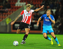 Harry Pell of Cheltenham Town competes with Luke Summerfield of Grimsby Town - Mandatory by-line: Nizaam Jones/JMP- 17/10/2017 - FOOTBALL - LCI Rail Stadium - Cheltenham, England - Cheltenham Town v Grimsby Town - Sky Bet League Two