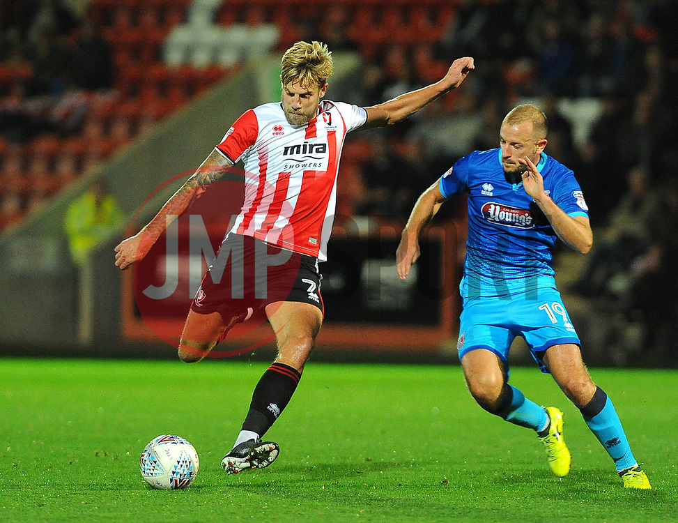 Harry Pell of Cheltenham Town competes with Luke Summerfield of Grimsby Town - Mandatory by-line: Nizaam Jones/JMP- 17/10/2017 - FOOTBALL - LCI Rail Stadium - Cheltenham, England - Cheltenham Town v Grimsby Town - Sky Bet League Two