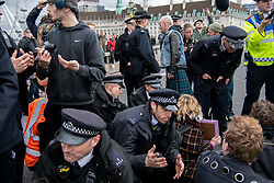 © Licensed to London News Pictures. 15/03/2019. London, UK. Police move in to to disperse an 'after party' held on Westminster Bridge, blocked traffic for several hours.  School children across the UK took part in an international day of action protesting inaction over climate change. An 'after party' was held on Westminster Bridge, blocking traffic for several hours.  Photo credit: Guilhem Baker/LNP