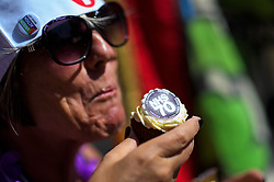 © Licensed to London News Pictures. 30/06/2018. London, UK.  A woman eats an NHS themed cup cake as Thousands of people take part in a march through central London to mark the 70th anniversary of the NHS. The UK's National Health Service was launched on July 5th, 1948 as part of major social reforms following the Second World War. Photo credit: Ben Cawthra/LNP