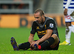 30.12.2012, Loftus Road, London, ENG, Premier League, Queens Park Rangers vs FC Liverpool, 20. Runde, im Bild Liverpool's Jose Enrique goes down with a hamstring injury during the English Premier League 20th round match between Queens Park Rangers and Liverpool FC at Loftus Road, London, Great Britain on 2012/12/30. EXPA Pictures © 2012, PhotoCredit: EXPA/ Propagandaphoto/ David Rawcliffe..***** ATTENTION - OUT OF ENG, GBR, UK *****