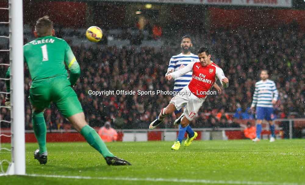 26 December 2014 Premier League Football - Arsenal v Queens Park Rangers ;  Santi Cazorla heads the opening goal for Arsenal.<br /> Photo: Mark Leech.
