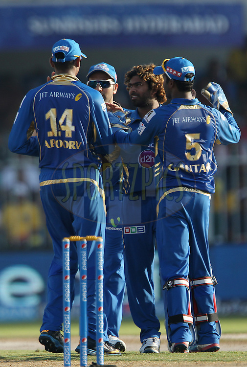 Lasith Malinga of the Mumbai Indians celebrates the wicket of Jean-Paul Duminy of the Delhi Daredevils during match 16 of the Pepsi Indian Premier League 2014 between the Delhi Daredevils and the Mumbai Indians held at the Sharjah Cricket Stadium, Sharjah, United Arab Emirates on the 27th April 2014<br /> <br /> Photo by Ron Gaunt / IPL / SPORTZPICS