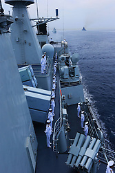 60098921<br /> Chinese naval soldiers stand in formation on Shenyang guided missile destroyer during a military review of the Joint Sea-2013 drill at Peter the Great Bay in Russia, July 10, 2013. The Joint Sea-2013 drill participated by Chinese and Russian warships concluded here in Peter the Great Bay in Russia on Wednesday, July 10, 2013.<br /> Photo by imago / i-Images