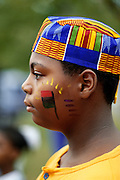 NJ, Holmdel, (Garden State Arts Center), Boy at African American festival at PNC Arts Center.