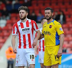 Cheltenham Town's Wes Burns and Exeter City's Jamie McAllister - Photo mandatory by-line: Nizaam Jones - Mobile: 07966 386802 - 21/03/2015 - SPORT - Football - Cheltenham - Whaddon Road - Cheltenham Town v Exeter City - Sky Bet League Two