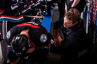 KELOWNA, CANADA - OCTOBER 20: Athletic therapist Scott Hoyer tends to Dillon Dube #19 of the Kelowna Rockets on the bench against the Portland Winterhawks on October 20, 2017 at Prospera Place in Kelowna, British Columbia, Canada.  (Photo by Marissa Baecker/Shoot the Breeze)  *** Local Caption ***