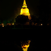 Wat Chana Songkhram at night in Sukhothai. The Sukhothai kingdom was an early Thai kingdom in north central Thailand. It existed from during the 13, 14, 15th centuries The.old capital is in ruins and is a Historical Park..View from Feb, 2007.