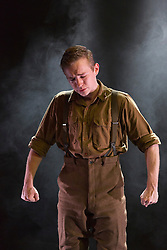 "© Licensed to London News Pictures. 23/05/2014. London, England. Actor Jack Holden performs in the one-man play ""Johnny Got His Gun"". Metal Rabbit brings the UK premiere of Dalton Trumbo's anti-war novel ""Johnny Got His Gun""  to Southwark Playhouse in an adaptation by Bradley Rand Smith. The play is directed by David Mercatali and marks the Centenary of the First World War. At Southwark Playhouse from 21 May to 14 June 2014. Photo credit: Bettina Strenske/LNP"