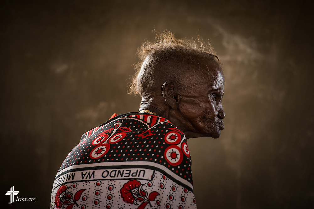 "A patient waits at the LCMS Mercy Medical Team pharmacy on Monday, June 20, 2016, in Nataparkakono, a village in Turkana, Kenya.  The words in Swahili on her attire translates to ""the Love of God."" LCMS Communications/Erik M. Lunsford"