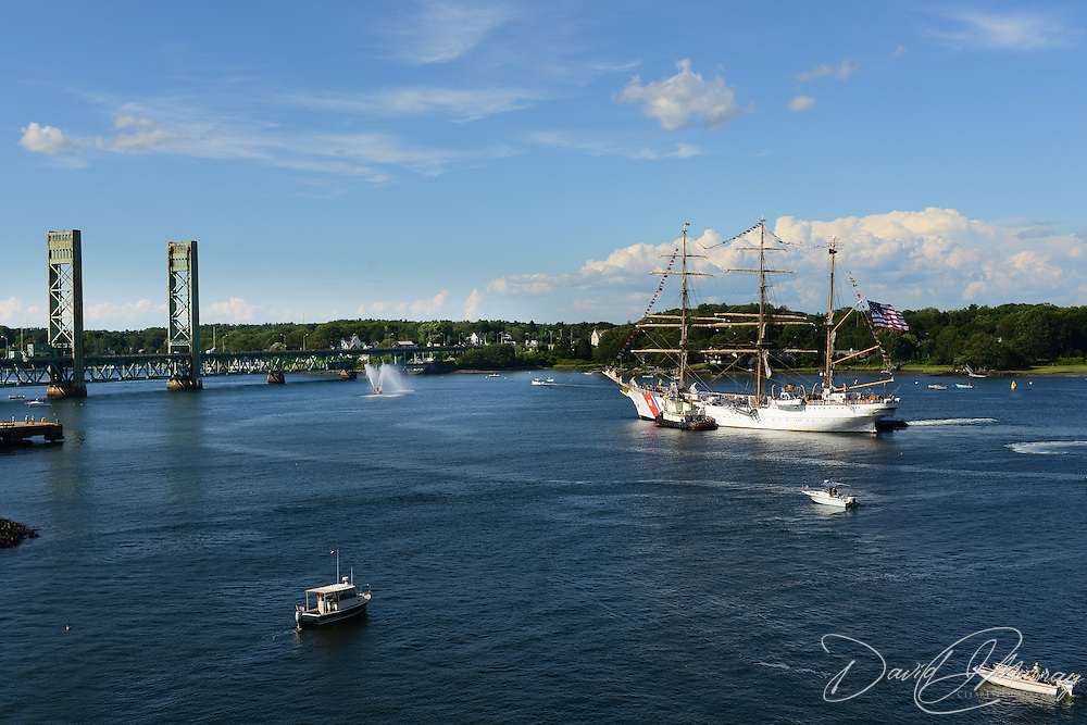 The U.S. Coast Guard Eagle sails into Portsmouth Harbor on August 2, 2013, to participate in Sail Portsmouth, hosted by the Piscataqua Maritime Commission. Kittery, ME and the Sarah Long Bridge are in the background.