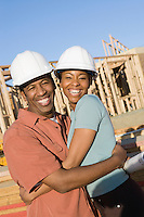 Enthusiastic couple in construction site