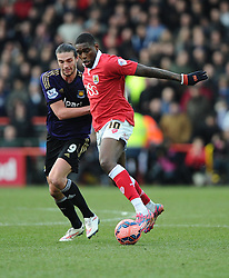 Bristol City's Jay Emmanuel-Thomas battles for the ball with West Ham's Andy Carroll  - Photo mandatory by-line: Joe Meredith/JMP - Mobile: 07966 386802 - 25/01/2015 - SPORT - Football - Bristol - Ashton Gate - Bristol City v West Ham United - FA Cup Fourth Round