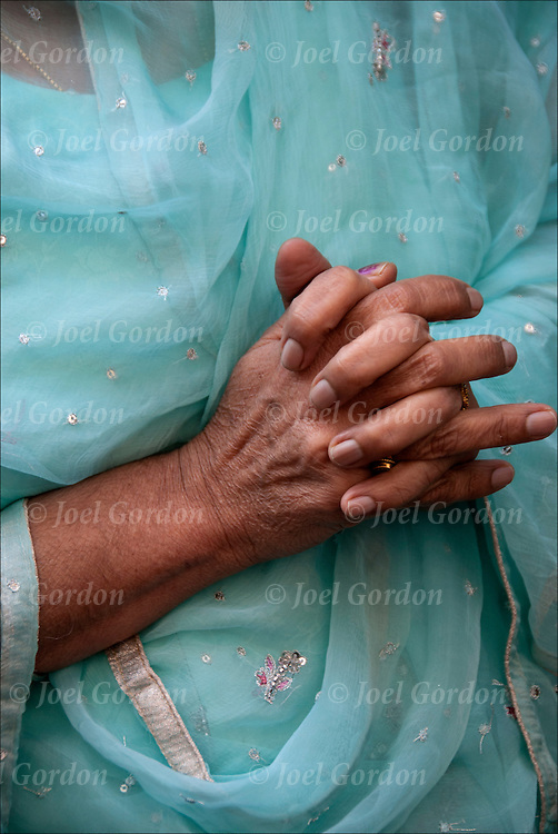 Close up of hands of Sikh-American woman's hands in prayer at the annual Sikh Day Parade in NYC.