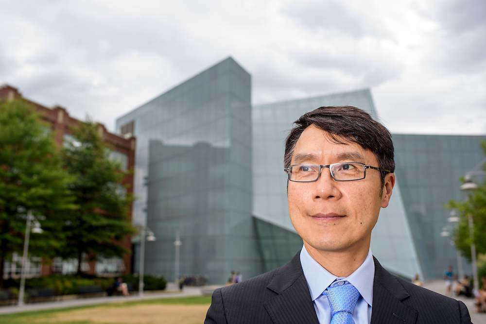 Baltimore, Maryland - July 21, 2014: <br /> <br /> Samuel Hoi, the president of MICA is photographed in front of the Brown Center, right, &amp; the Fox Builing, left.<br /> <br /> U.S. culture has a stereotype about &quot;starving artists,&quot; and high priced art colleges like MICA might not seem to some like a good return on investment.<br /> CREDIT: Matt Roth