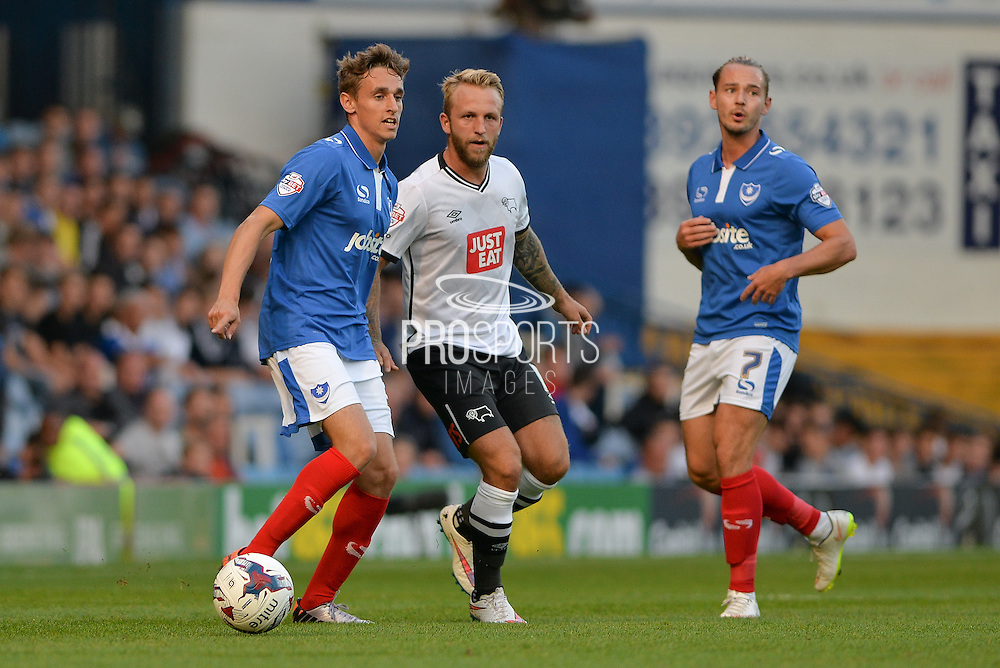 Brandon Haunstrup, Johnny Russell and Adam McGurk during the Capital One Cup match between Portsmouth and Derby County at Fratton Park, Portsmouth, England on 12 August 2015. Photo by Adam Rivers.