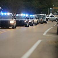 The funeral procession makes it's way through the town of Bruce for former police chief Stanley Evans Saturday.