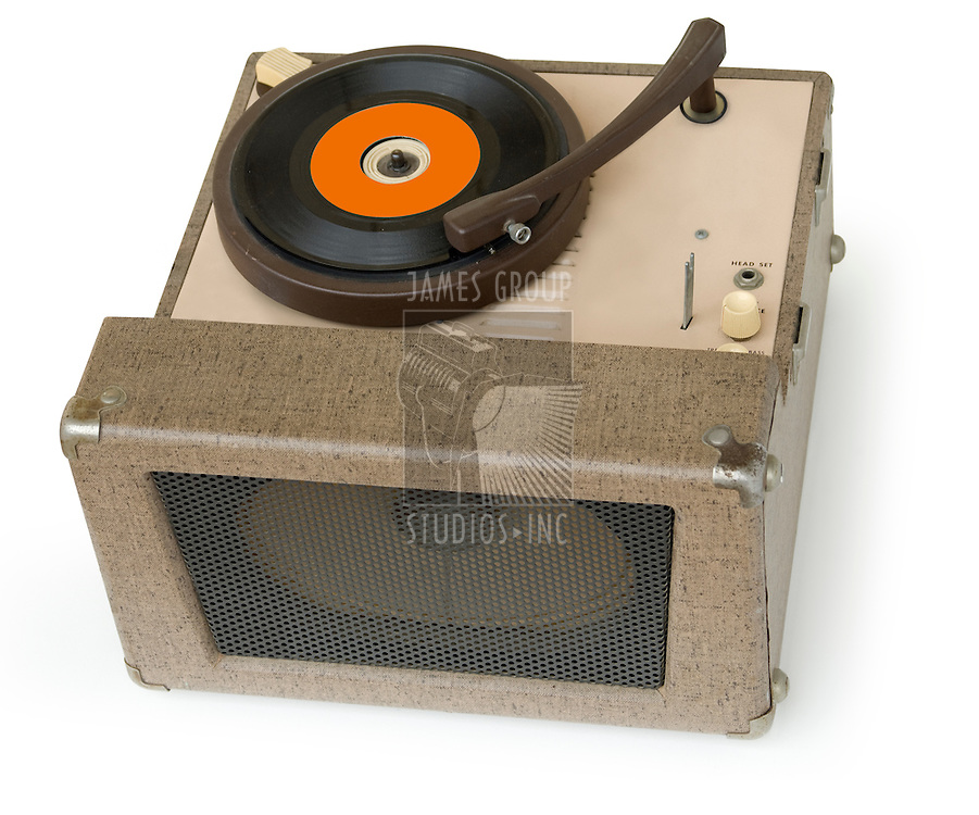 50s era phonograph playing a 45 single vinyl record isolated on a white background with clipping path