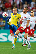 Lublin, Poland - 2017 June 19: (L) Gustav Engvall from Sweden U21 fights for the ball with (R) Jaroslaw Jach from Poland U21 while Poland v Sweden match during 2017 UEFA European Under-21 Championship at Lublin Arena on June 19, 2017 in Lublin, Poland.<br /> <br /> Mandatory credit:<br /> Photo by &copy; Adam Nurkiewicz / Mediasport<br /> <br /> Adam Nurkiewicz declares that he has no rights to the image of people at the photographs of his authorship.<br /> <br /> Picture also available in RAW (NEF) or TIFF format on special request.<br /> <br /> Any editorial, commercial or promotional use requires written permission from the author of image.