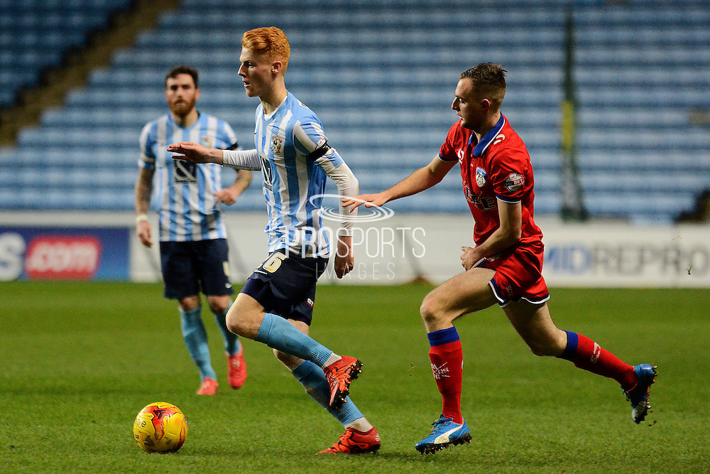 Coventry City defender Ryan Haynes being tracked by Oldham Athletic midfielder Carl Winchester during the Sky Bet League 1 match between Coventry City and Oldham Athletic at the Ricoh Arena, Coventry, England on 19 December 2015. Photo by Alan Franklin.