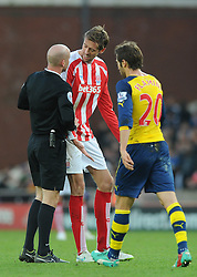 Stoke's Peter Crouch argues with Referee, Anthony Taylor - Photo mandatory by-line: Dougie Allward/JMP - Mobile: 07966 386802 - 06/12/2014 - SPORT - Football - Stoke - Britannia Stadium - Stoke City v Arsenal - Barclays Premie League