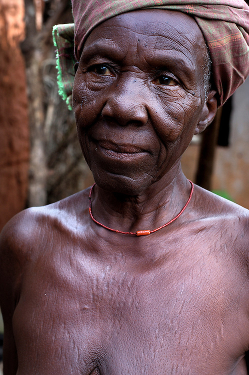 Benin, Tory April 17, 2005 - Old woman with scarification, It represents the voodoo python