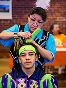 06 MAY 2017 - ST. PAUL, MN: KARLENE CHOSA helps her son, LEON CHOSA, both of the Bois Forte Band of Chippewa, near International Falls, MN, get ready for the 6th Annual Powwow for Hope at Ft. Snelling in St. Paul. The powwow was a fundraiser to support cancer education and supportive services for American Indian communities. Proceeds benefited the American Indian Cancer Foundation's work to eliminate cancer burdens on American Indian families. Cancer is the leading cause of death in Native American communities, exceeding coronary disease and diabetes.       PHOTO BY JACK KURTZ