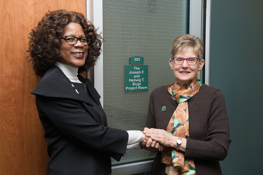 Mary Frances Bryja, right, and Dean Renee Middleton stand in front of the new project room named after Bryja's parents  on the second floor of the newly renovated McCracken Hall on January 27, 2017.