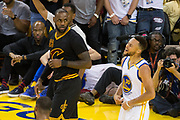 Golden State Warriors guard Stephen Curry (30) celebrates a basket as Cleveland Cavaliers forward LeBron James (23) looks on during Game 2 of the NBA Finals at Oracle Arena in Oakland, Calif., on June 4, 2017. (Stan Olszewski/Special to S.F. Examiner)