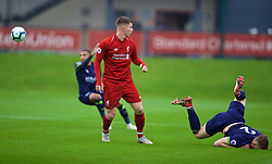 KIRKBY, ENGLAND - Sunday, October 21, 2018: Liverpool's Ben Woodburn (L) and Derby County's Joe Bateman during the Under-23 FA Premier League 2 Division 1 match between Liverpool FC and Derby County at The Kirkby Academy. (Pic by David Rawcliffe/Propaganda)