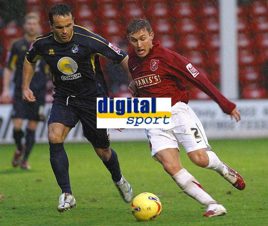 Photo: Dave Linney.<br />Walsall v Bristol Rovers. Coca Cola League 2. 30/12/2006.  Walsall's Craig Pead(R) takes on   Sammy Igoe.