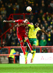 Aden Flint of Bristol City challenges for a header with Cameron Jerome of Norwich City - Mandatory by-line: Dougie Allward/JMP - 07/03/2017 - FOOTBALL - Ashton Gate - Bristol, England - Bristol City v Norwich City - Sky Bet Championship