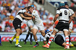 Sam Hill (England) is tackled in possession - Photo mandatory by-line: Patrick Khachfe/JMP - Tel: Mobile: 07966 386802 01/06/2014 - SPORT - RUGBY UNION - Twickenham Stadium, London - England XV v Barbarians - International Friendly.