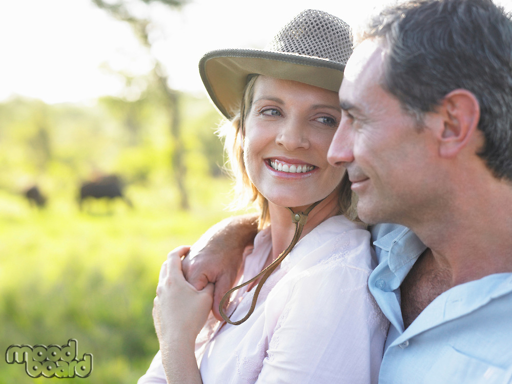 Portrait of adult couple woman looking at man smiling