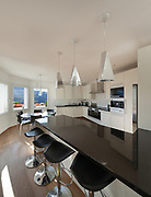 Interior of  house, counter top of a kitchen with stools