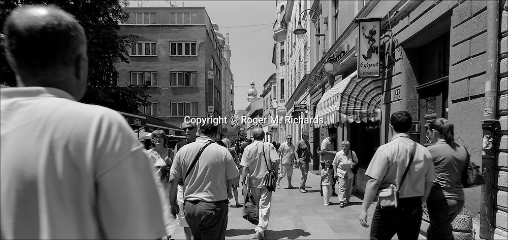 Pedestrians walk along Ferhadija, in the Bascarsija neighborhood of Sarajevo, July 2008.