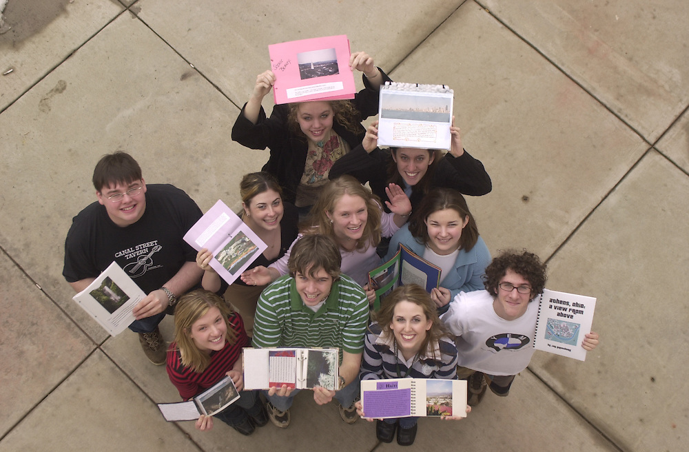 15783Laura's residential learning community group view from above class holding work